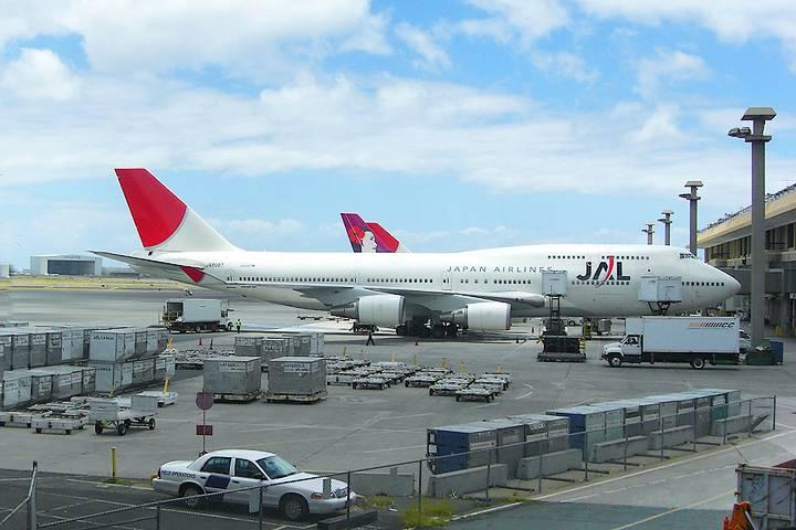 Plane near cargo area