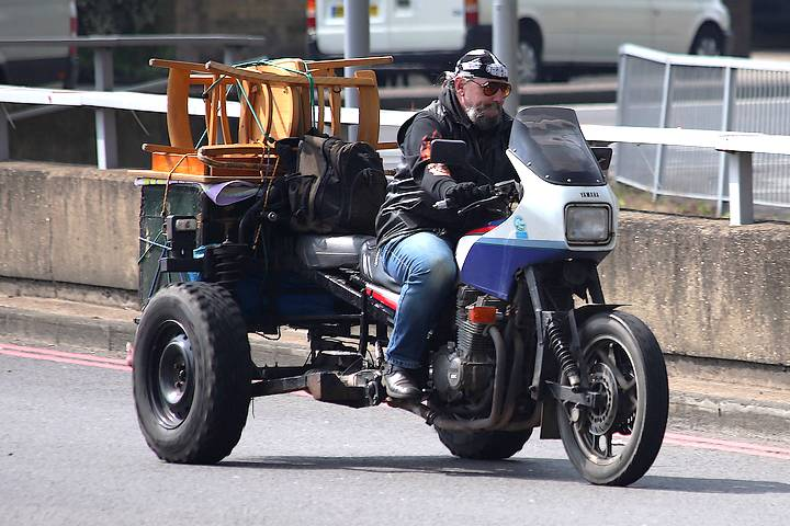 Furniture being moved on motorcycle
