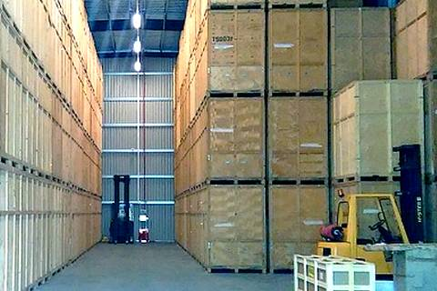 Storage containers in large warehouse